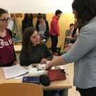 Cara Epstein working with 2 students
