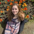 Elliza O'Grady in a field of flowers.