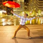 Keshav Mantha striking a traditional Bhangra pose with an umbrella outside City Hall!