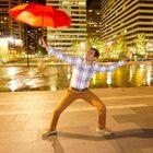 Keshav Mantha striking a traditional Bhangra pose with an umbrella outside City Hall!