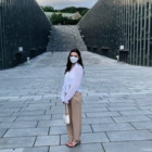 This is a picture of me at the iconic Ewha Campus Complex— taking a picture here is a right of passage for Ewha students.