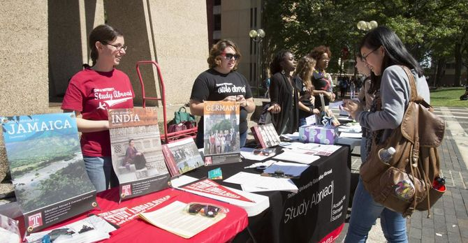 Students at the Bell Tower learning more about study abroad