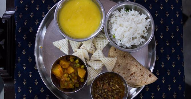 Indian lunch: mango puree, curried lentils and vegetables, rice and chips