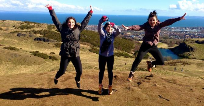 Students jumping for joy in the UK