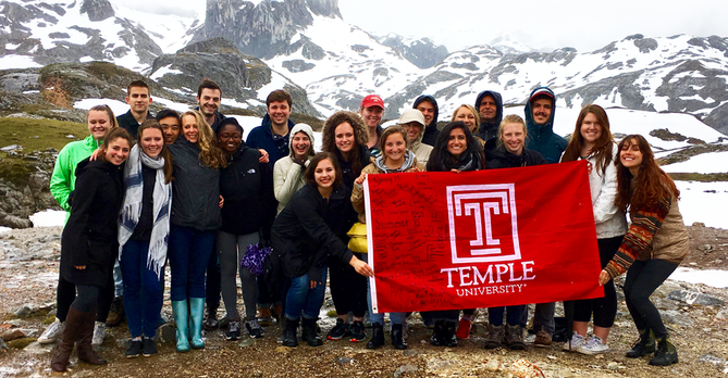 Group Photo with Temple Flag at Picos Mountains Mina Tatar